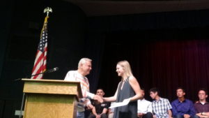 Colleen accept award from Hal